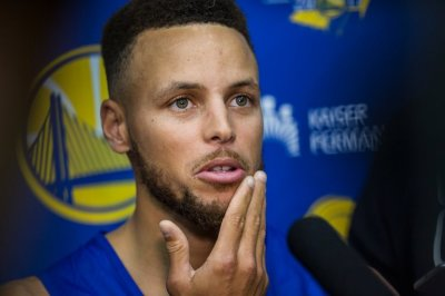 "alt=""Stephen Curry, on a 'Surreal' Day, Confronts a Presidential Snub"""