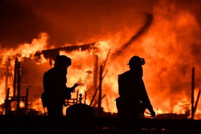 """alt=""""California Fires Kill at Least 10 and Destroy 1,500 Buildings"""""""