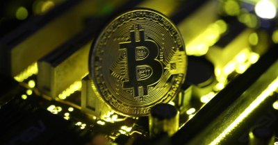 "alt=""Bitcoin drops 15% amid controversy over digital currency's future"""