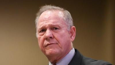 "alt=""Trump silent on Roy Moore amid calls for Senate hopeful to step aside"""