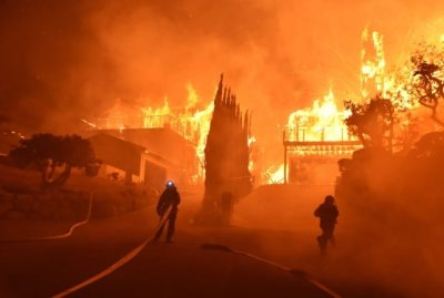 "alt=""California communities under siege from wind-driven fires"""