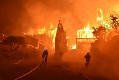 "alt=""California communities under siege from wind-driven fires"""
