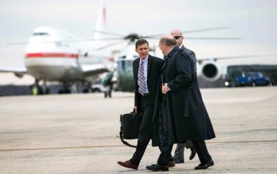 "alt=""Trump Will 'Look Into' Reports That Flynn Discussed Sanctions With Russia"""