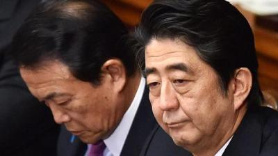 "alt=""Japan's Abe, finance minister are under fire over suspected cronyism scandal"""