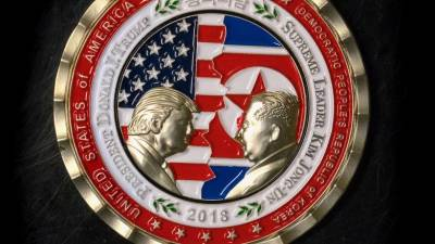 "alt=""Commemorative coin of Trump & Kim Jong-un released as North Korea summit uncertain"""