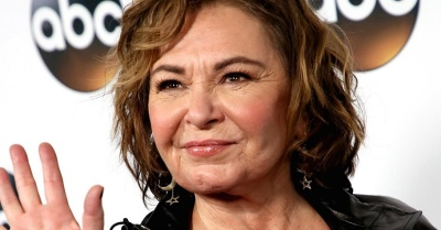 "alt=""ABC cancels 'Roseanne' after she compares black Obama aide Valerie Jarrett to an ape"""
