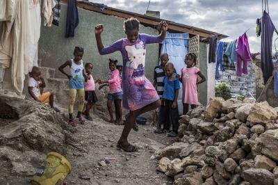 "alt=""Eking out a living in Haiti's colourful slum city"""