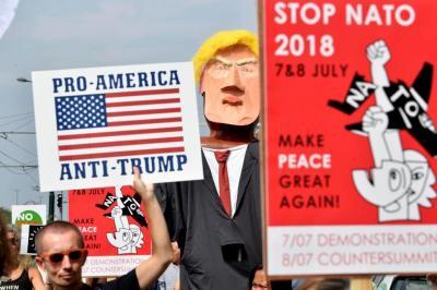 """alt=""""European Peace Activists March Against Trump's NATO Visit"""""""