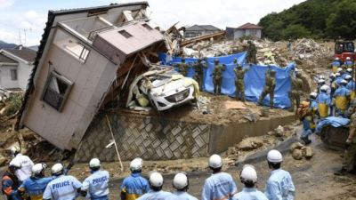 "alt=""Japan floods: At least 100 dead after record rainfall"""