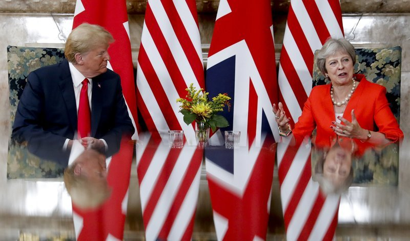 """alt=""""Protests, diplomatic backflips mark Trump's visit to England"""""""