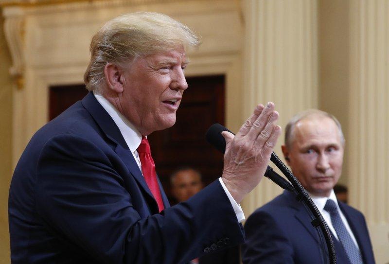 "alt=""Trump questions US intel, not Putin, on Russia 2016 meddling"""