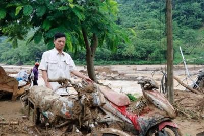 "alt=""Storms, landslides and heat hit Asia"""