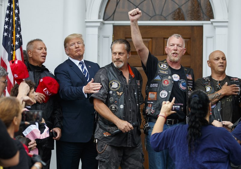"alt=""Rain pouring, Trump rages on Twitter and hangs with bikers"""