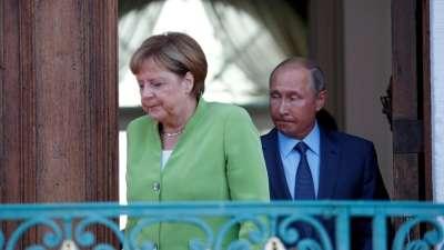 """alt=""""Merkel, Putin tackle tough topics in meeting outside Berlin"""""""