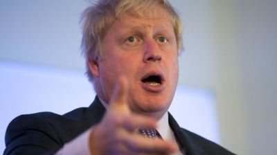 """alt=""""May wraps 'suicide vest' around UK over Brexit, says Johnson"""""""