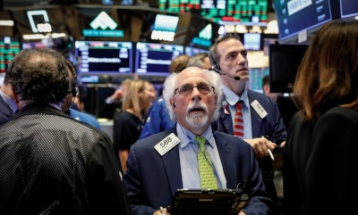 "alt=""Wall Street rally fizzles, U.S. dollar rises, after Fed rate hike"""