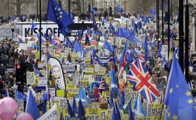 """alt=""""One million join march against Brexit as Tories plan to oust May"""""""