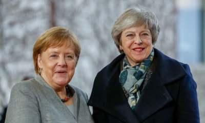 """alt=""""Merkel and Macron under pressure as May seeks new Brexit delay"""""""