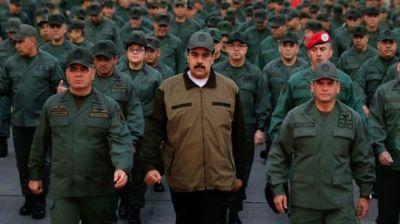 """alt=""""Venezuela crisis: Defiant Maduro appears with soldiers"""""""