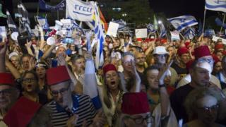 "alt=""Israel protests: Thousands rally against Netanyahu immunity"""