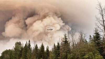 """alt=""""New evacuation orders issued as 'aggressive' northern Alberta wildfires grow"""""""