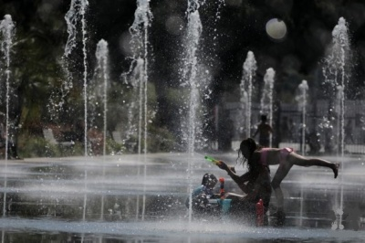 """alt=""""Wildfires and power cuts plague Europeans as heatwave breaks records"""""""