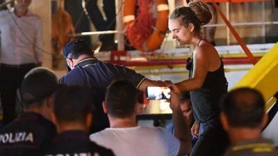 """alt=""""Italy migrants: Migrants allowed off charity ship despite ban"""""""