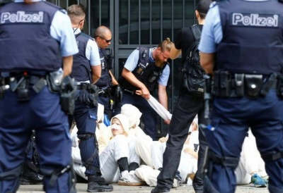"""alt=""""Climate protesters arrested outside Swiss banks"""""""