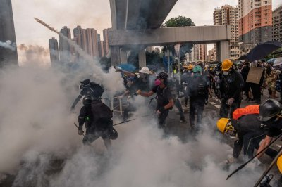 """alt=""""Clashes and Tear Gas as Hong Kong Police Confront Protesters in Yuen Long"""""""