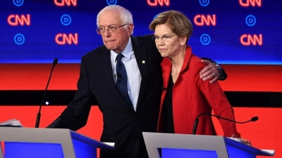 """alt=""""Sanders & Warren Battle Accusations of 'Fairy Tale' Promises as Intraparty Rift Flares"""""""