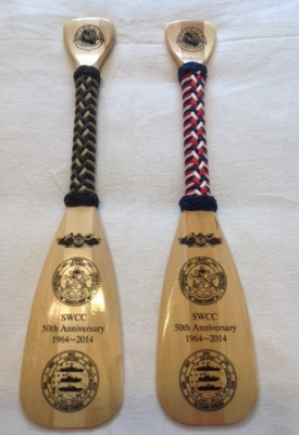 small, softwood paddle with engraving and handle wrap