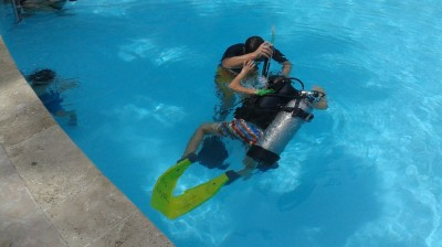 My kids learning to Scuba-dive a The Royal Resorts pools!