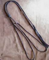 Leather braids loop over the crown