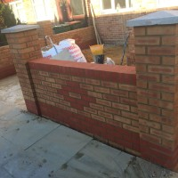 brick wall front garden with motif