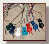 Graceful bead necklace features little deerskin neck pouch