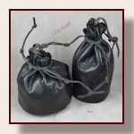 Round flat bottom leather bullet marble bag, hand stitched