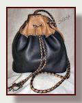 Flat bottom drawstring leather shoulder bag