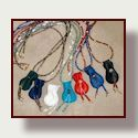 Go to beaded necklace with focal deerskin pouch.