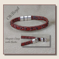 Go to slim leather band bracelets with tiny black seed beads.