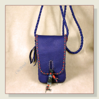 Strap on this cell phone day or evening bag is perfect for cross body wear.
