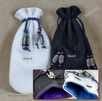 White or black leather bags are anti-tarnish cloth lined.