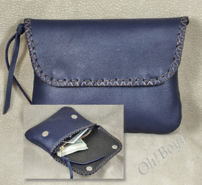 Larger version of soft wallet - clutch or purse organizer.