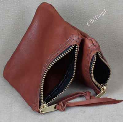 Leather zippered coin purses in two sizes, stitched by hand.