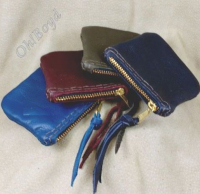 Smaller size 3x3-inch zippered coin purses also come in several leather colors.