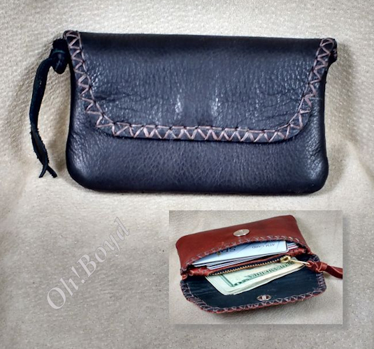 Useful wallet has three sections, fits front pants pocket.
