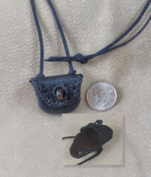 A traditional OhBoyd neck pouch with bead button flap closure.