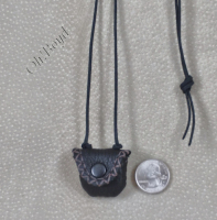 A tiny flap closure necklace pouch closes firmly with a snap.