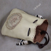 Roomy pouch is fully lined with another layer of deerskin.