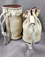 Lined deerskin round bottom marble or bullet pouch sits flat.