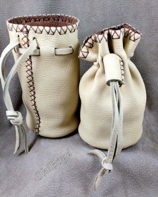 An all deerskin, completely hand stitched sit-flat pouch for bullets, rocks, marbles, more.